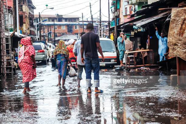 flood in african city - lagos, nigeria - nigeria stock pictures, royalty-free photos & images