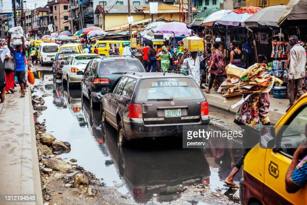 """flood in african city - lagos, nigeria - """"peeter viisimaa"""" or peeterv stock pictures, royalty-free photos & images"""