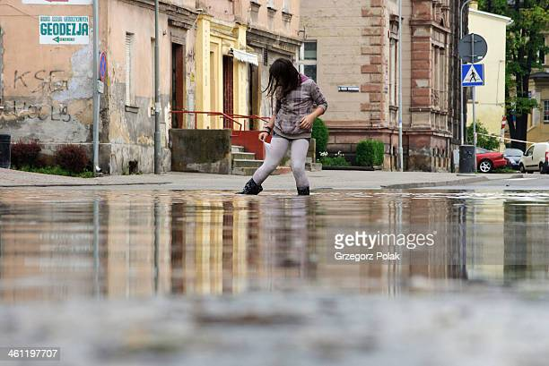 CONTENT] Flood in Lower Silesia Poland the town of Kamienna Gora 2nd of June 2013 A teenage girl is going along the flooded street and trying not to...