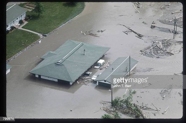 A flood partially submerges a house May 23 1980 in Washington State On May 18 an earthquake caused a landslide on Mount St Helens'' north face taking...