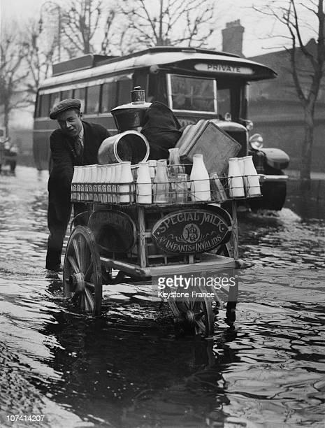 Flood Scene In A Street Milk Man At Shepperton In United Kingdom On February 1933