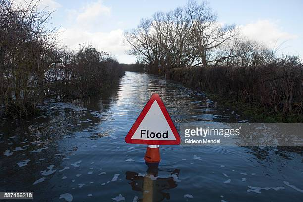 Flood sign on the flooded road to Muchelney a small village on the Somerset Levels that has been cut off by floodwaters for more than a month In the...