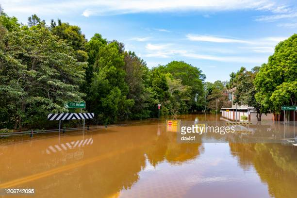 flood sign under water in the lismore cbd - flood stock pictures, royalty-free photos & images