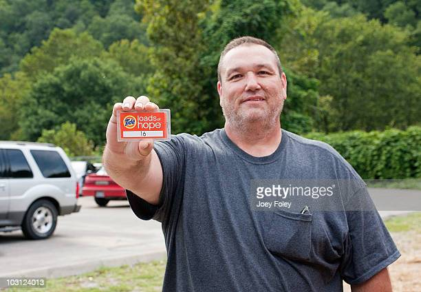 Flood victim Bobby Mullins shows us the tag he needs to pick up his clean clothes after dropping them off at Tide's Loads Of Hope mobile laundry...