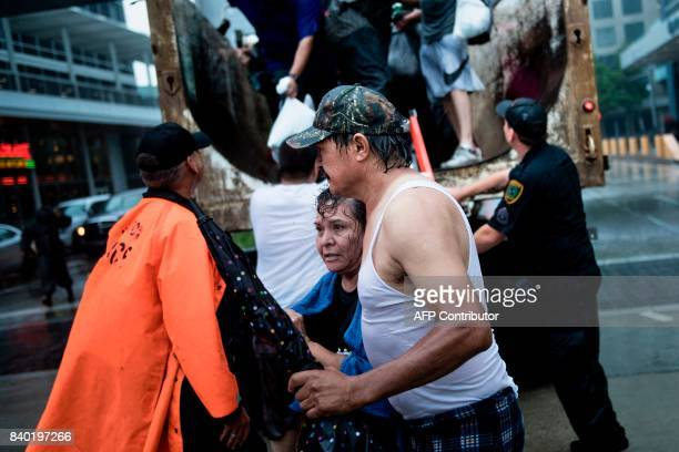 TOPSHOT Flood victims arrive at a shelter in the George R Brown Convention Center during the aftermath of Hurricane Harvey on August 28 2017 in...