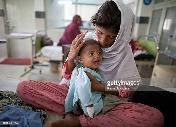 Flood victims pack a ward for women and children suffering from gastroenteritis and diarrhea at the Muzaffargarh hospital August 28 2010 in...