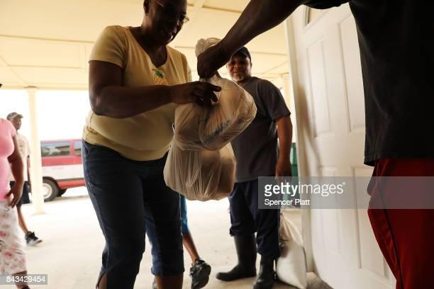 Flood victims recieve food and other essentials from a local church in Orange as Texas slowly moves toward recovery from the devastation of Hurricane...