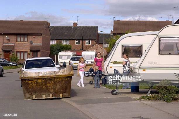 Flood victims stand near caravans outside their homes on California Drive in Catcliffe Sheffield UK on Tuesday Aug 7 2007 Six weeks after floods hit...