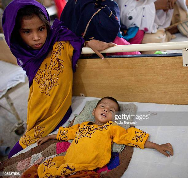 Flood victims suffering from gastroenteritis and diarrhea pack a government hospital ward for flood effected children on August 21 2010 in Sukkur...