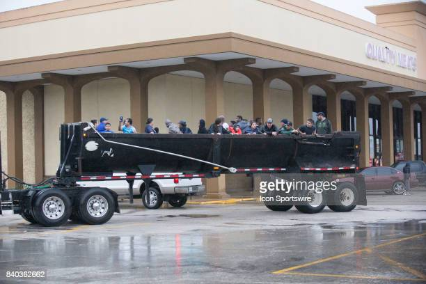 Flood victims were rescued in big trucks from their homes taken to a local Food Town grocery store to be taken to shelters during Hurricane Harvey...