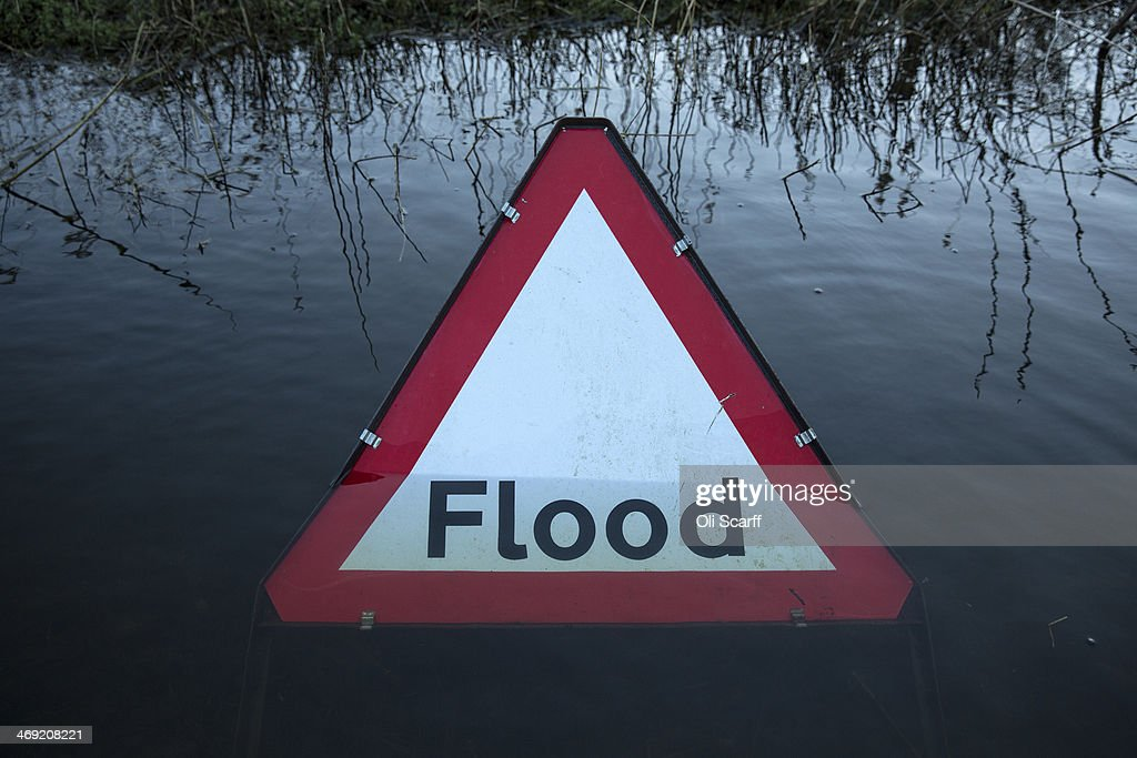 A flood warning road sign on a partially submerged road near the river Thames on February 13, 2014 in Wargrave, England.The Environment Agency continues to issue severe flood warnings for a number of areas on the River Thames in the commuter belt west of London. With heavier rains forecast, people are preparing for the water levels to rise.