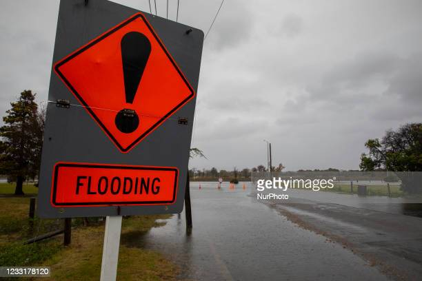 Flood warning sign is seen in New Brighton, Christchurch, NewZealand on May 30, 2021.MetService has put in place code red severe weather warning...