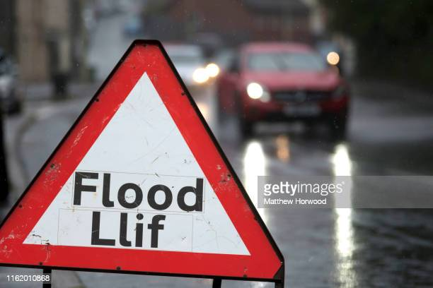 Flood warning sign on a flooded road on August 16, 2019 in Pontypridd, Wales. The Met Office have issued a yellow weather warning for rain for Wales...