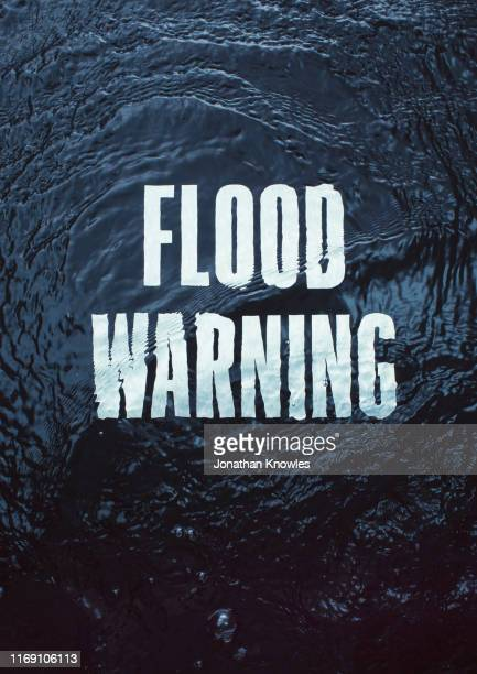flood warning text under water - water stock pictures, royalty-free photos & images