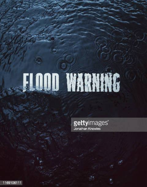 flood warning under water - flood stock pictures, royalty-free photos & images