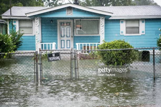 Flood water accumulates in the front yard of a home on September 5 2019 in Georgetown South Carolina Hurricane Dorian spins just off shore of the...