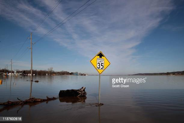 CRAIG MISSOURI MARCH 22 Flood water covers Highway 59 as it approaches town on March 22 2019 in Craig Missouri Midwest states are battling some of...