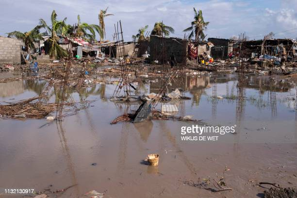 Flood water covers the ground between rubble where there once use to be houses at an informal settlement in Beira, the fourth largest city in...