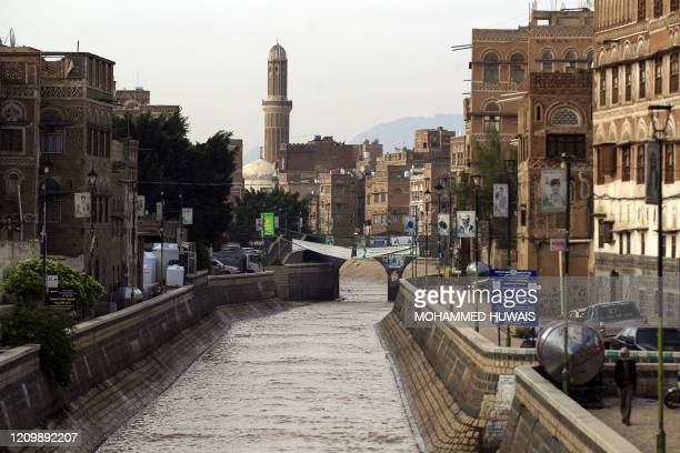 Flood water fills a canal following heavy rains in the Old City of Yemen's capital Sanaa on April 14, 2020.