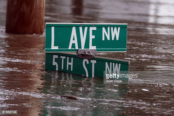 Flood water nearly covers a street sign June 13, 2008 in Cedar Rapids, Iowa. The city continues to evacuate residents as water from the rain-soaked...