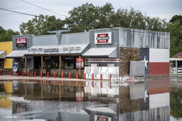 Flood water surrounds a convenient store and pizza shop following Tropical Storm Imelda in Fannett Texas US on Friday Sept 20 2019 The remnants of...