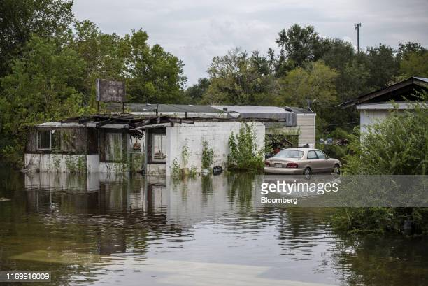 Flood water surrounds a home following Tropical Storm Imelda in Hillshire Texas US on Friday Sept 20 2019 The remnants of Tropical Storm Imelda...