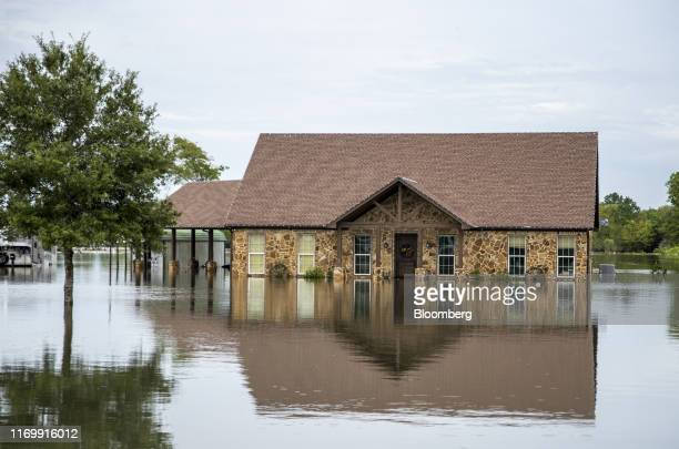 Flood water surrounds a home following Tropical Storm Imelda in Fannett Texas US on Friday Sept 20 2019 The remnants of Tropical Storm Imelda lashed...