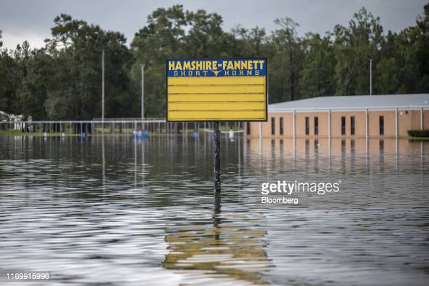 Flood water surrounds a sign for HamsireFannett High School following Tropical Storm Imelda in Fannett Texas US on Friday Sept 20 2019 The remnants...