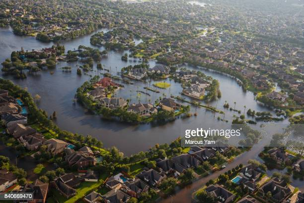 HOUSTON TEXAS TUESDAY AUGUST 29 2017 Flood water surrounds homes in a residential neighborhood in the wake of Hurricane Harvey on August 29 2017 in...