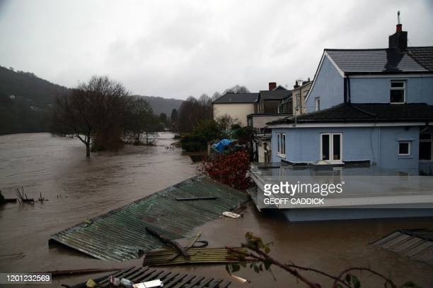 Flood water surrounds houses after the River Taff burst its banks in Taffs Wells, north of Cardiff, in south Wales on February 16 after Storm Dennis...