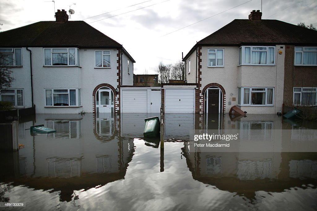 Flood water surrounds housing on February 13, 2014 in Staines-Upon-Thames, England. Flood water has remained high in some areas and high winds are causing disruption to other parts of the UK with the Met Office issuing a red weather warning.