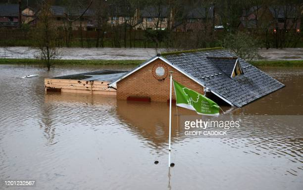 Flood water surrounds the bowling club after the River Taff burst its banks in Taffs Wells north of Cardiff in south Wales on February 16 after Storm...