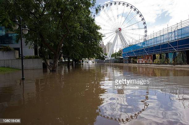 Flood water surrounds The Wheel in the suburb of South Bank on January 13 2011 in Brisbane Australia The Brisbane river peaked at 446 metres today a...