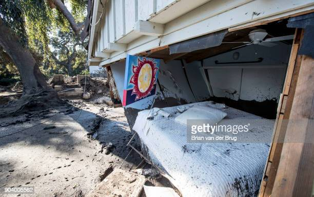 Flood waters and mud pushed out the wall of a bedroom where a woman was reported missing by friends and family but was later found to be safe on...