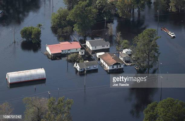 Flood waters are seen surrounding a home after heavy rains from Hurricane Florence on September 20, 2018 in Lumberton, North Carolina. Residents have...