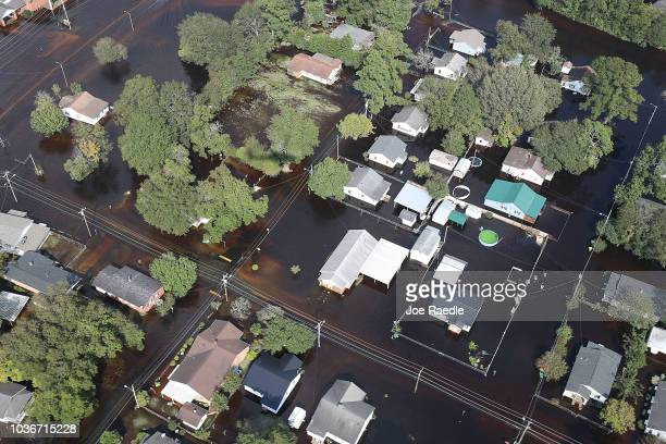 Flood waters are seen surrounding homes after heavy rains from Hurricane Florence on September 20, 2018 in Lumberton, North Carolina. Residents have...