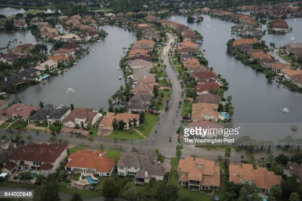 Flood waters are seen surrounding houses and apartment complexes in West Houston TX on Wednesday Aug 30 2017 Hurricane now Tropical Storm Harvey...