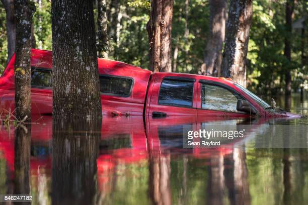 Flood waters caused by Hurricane Irma inundate a vehicle September 12 2017 in Middleburg Florida United States The storm brought flooding to areas...