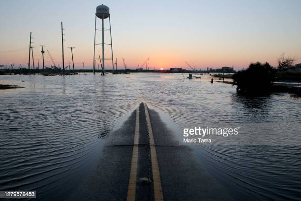 Flood waters cover a roadway near structures damaged by Hurricane Laura on October 10, 2020 in Cameron, Louisiana. Hurricane Delta made landfall as a...