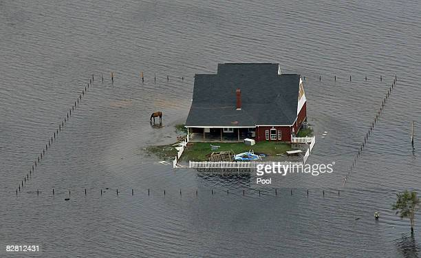 Flood waters engulf a home after Hurricane Ike passed through September 14 2008 near Winnie Texas Floodwaters from Hurricane Ike are reportedly as...