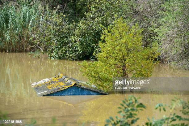 TOPSHOT Flood waters engulf the land and buildings on October 15 2018 in Villemoustaussou near Carcassone southern France Thirteen people have died...