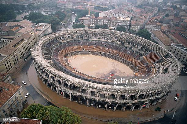 Flood waters enter and surround the arena of Nimes