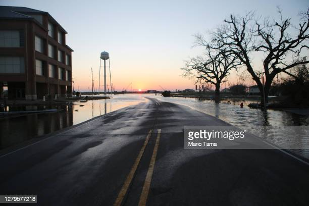 Flood waters from Hurricane Delta cover a roadway near structures damaged by Hurricane Laura on October 10, 2020 in Cameron, Louisiana. Hurricane...