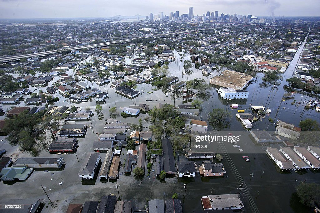 Flood waters from Hurricane Katrina cover streets 30 August, 2005 in New Orleans, Louisiana. It is estimated that 80 percent of New Orleans is under flood waters as levees begin to break and leak around Lake Ponchartrain. AFP PHOTO/POOL/Vincent Laforet