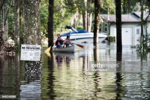 Flood waters from the Black Creek inundate a neighborhood after Hurricane Irma September 12, 2017 in Middleburg, Florida, United States. The storm...