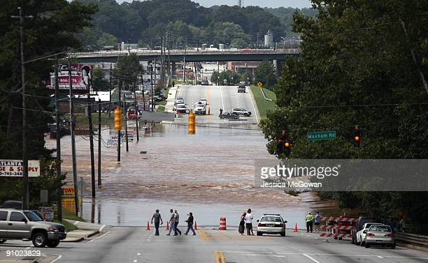 Flood waters from the Sweetwater Creek stream across the closed Veterans Memorial Highway September 22 2009 in Austell Georgia Flooding due to heavy...