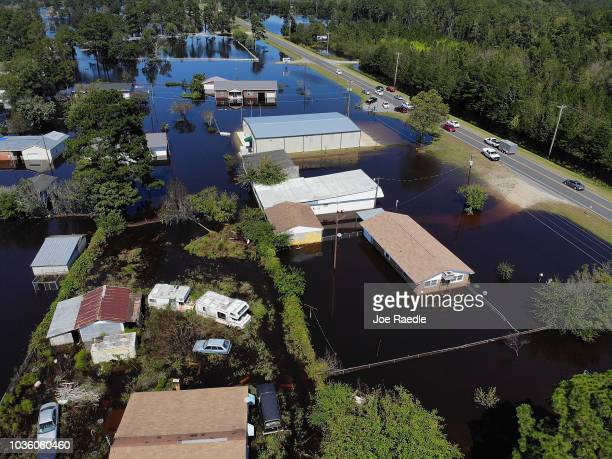 Flood waters isolate homes after heavy rains from Hurricane Florence on September 19, 2018 in Lumberton, North Carolina. The death toll from the...