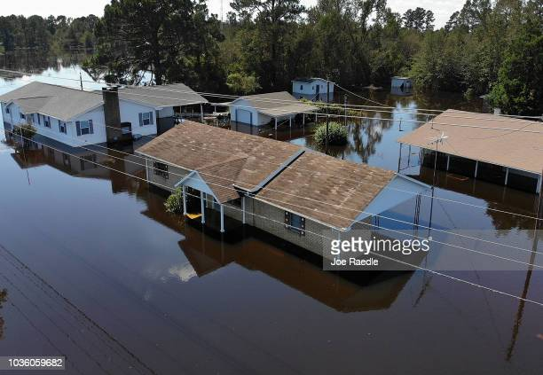 Flood waters isolate homes in the aftermath of Hurricane Florence September 19, 2018 ian Lumberton, North Carolina. The death toll from the storm...