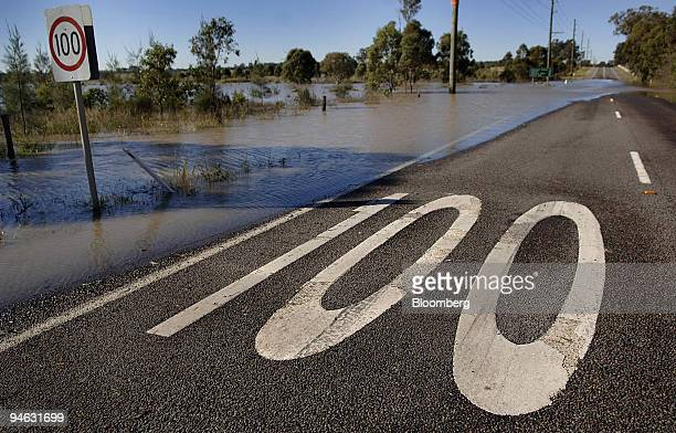 Flood waters start to cover up a road in the town of Maitland north of Sydney Australia on Wednesday June 13 2007 The fourday storm the worst in New...