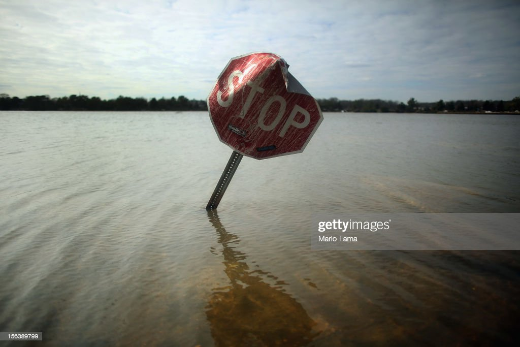 Flood waters surround a stop sign on November 14, 2012 in Bay Head, New Jersey. Many residents of the hard hit seaside town remain without power following Superstorm Sandy.
